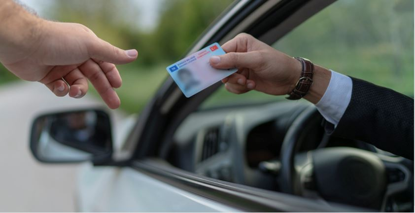 Person showing driver's license